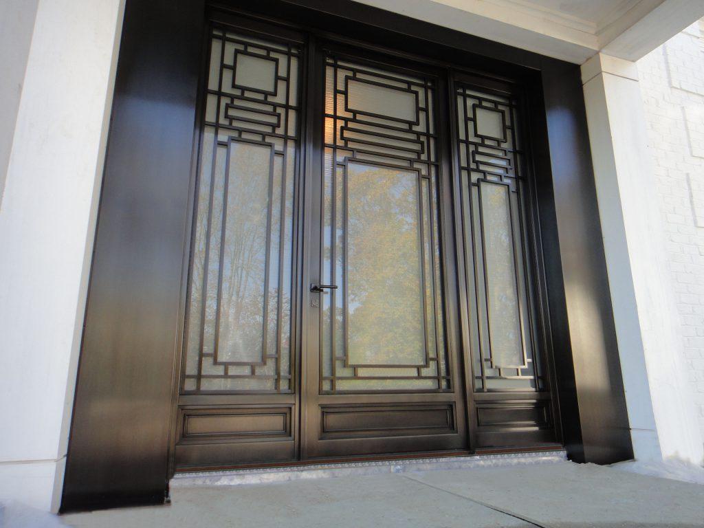 Monumental Bronze Entry Door with Sidelights.